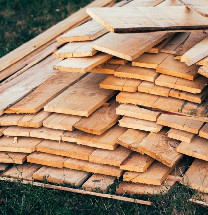 Stack of wooden planks on construction site